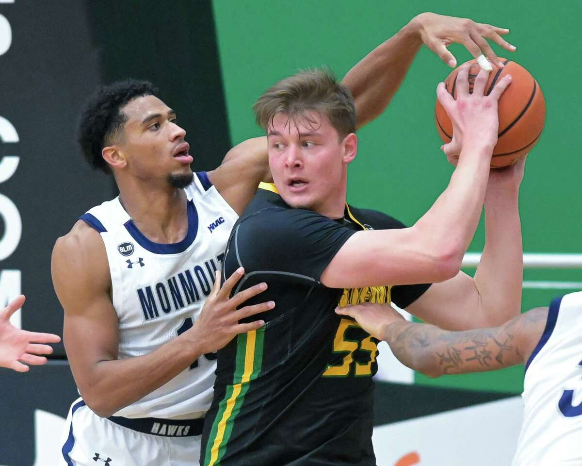 Siena senior Jackson Stormo, right, is working on his low post moves this summer, but is also working on becoming a 3-point threat.
