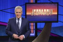 "FILE - This image released by Jeopardy! shows Alex Trebek, host of the game show ""Jeopardy!"" Trebek's final week of episodes will air Monday, Jan. 4 through Friday, Jan. 8, 2021. All five episodes were taped in late October. (Jeopardy! via AP)"