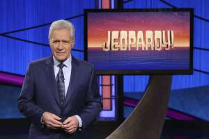 """FILE - This image released by Jeopardy! shows Alex Trebek, host of the game show """"Jeopardy!"""" Trebek's final week of episodes will air Monday, Jan. 4 through Friday, Jan. 8, 2021. All five episodes were taped in late October. (Jeopardy! via AP)"""
