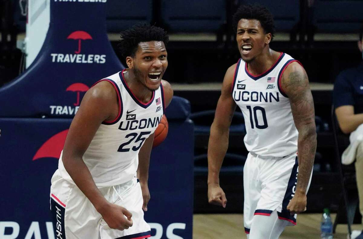 Connecticut forward Josh Carlton (25) reacts after making a basket against DePaul during the first half of an NCAA college basketball game Wednesday, Dec. 30, 2020, in Storrs, Conn. (David Butler II/Pool Photo via AP)