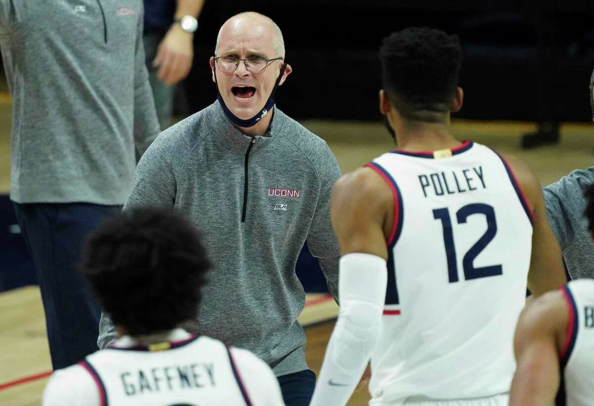 Connecticut coach Dan Hurley reacts during a break in the first half against DePaul in an NCAA college basketball game Wednesday, Dec. 30, 2020, in Storrs, Conn. (David Butler II/Pool Photo via AP)