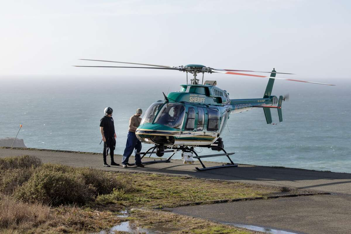 Sonoma County's Henry 1 search and rescue helicopter lands at the Blind Beach overlook.