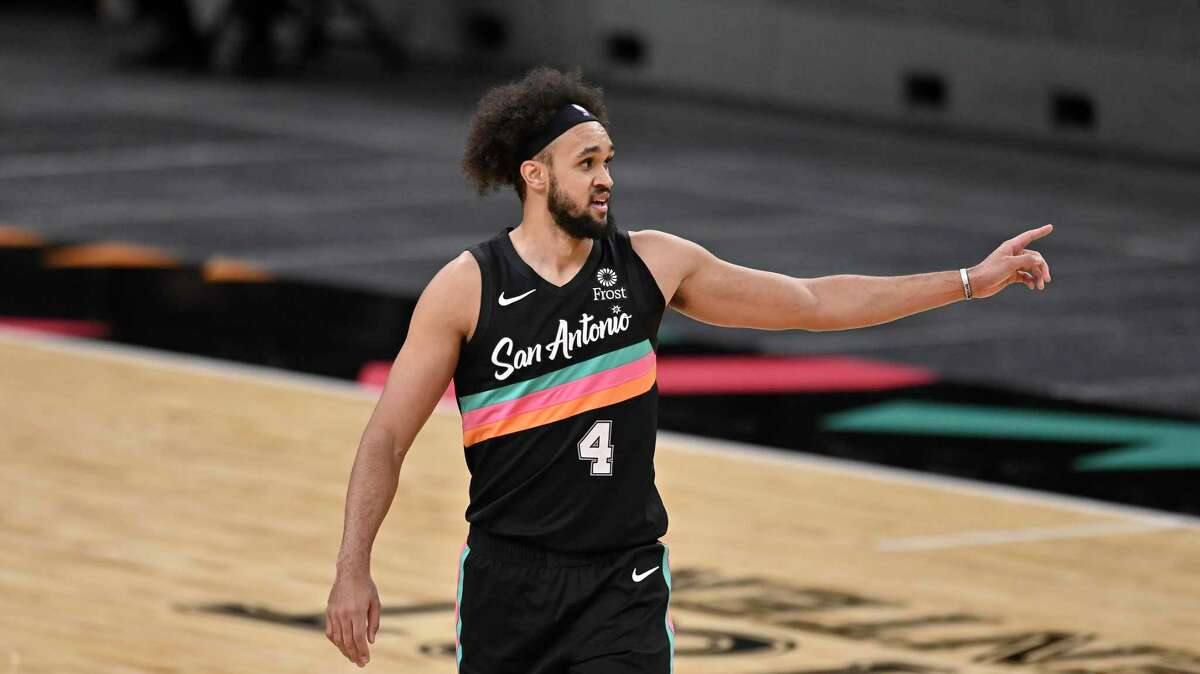 San Antonio Spurs' Derrick White walks up the court during the first half of an NBA basketball game against the Los Angeles Lakers, Friday, Jan. 1, 2021, in San Antonio. (AP Photo/Darren Abate)