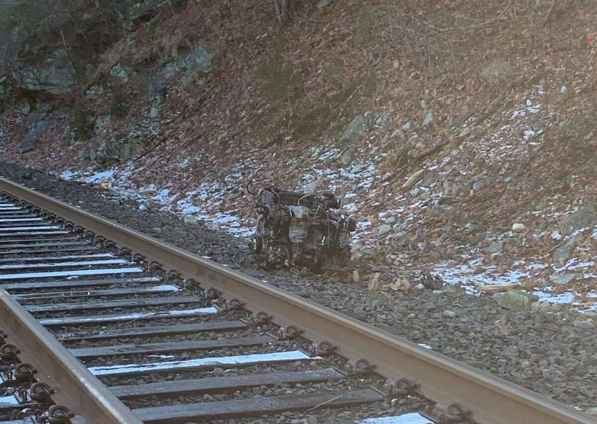 BEACON FALLS, Conn. - One person was transported to Waterbury Hospital in full trauma alert after a car crashed off of Route 8 near Cold Spring Road and Lopus Road Extension and fell near the train tracks below the highway Monday, Jan. 4, 2021.