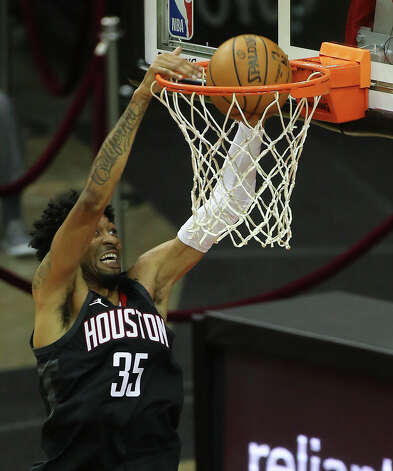 Houston Rockets forward Christian Wood (35) dunks the ball with a relay from James Harden during the third quarter of a NBA game against the Dallas Mavericks Monday, Jan. 4, 2021, at Toyota Center in Houston. Photo: Yi-Chin Lee/Staff Photographer / © 2021 Houston Chronicle