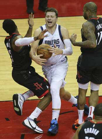 Dallas Mavericks guard Luka Doncic (77) offensive fouls on Houston Rockets David Nwaba (2) during the third quarter of a NBA game Monday, Jan. 4, 2021, at Toyota Center in Houston. Photo: Yi-Chin Lee/Staff Photographer / © 2021 Houston Chronicle