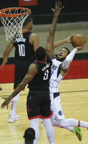 Dallas Mavericks guard Jalen Brunson (13) goes up for the basket while Houston Rockets guard Sterling Brown (0) is trying to stop him during the fourth quarter of a NBA game Monday, Jan. 4, 2021, at Toyota Center in Houston. Photo: Yi-Chin Lee/Staff Photographer / © 2021 Houston Chronicle