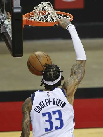 Dallas Mavericks center Willie Cauley-Stein (33) dunks the ball during the fourth quarter of a NBA game against the Houston Rockets Monday, Jan. 4, 2021, at Toyota Center in Houston. Photo: Yi-Chin Lee/Staff Photographer / © 2021 Houston Chronicle