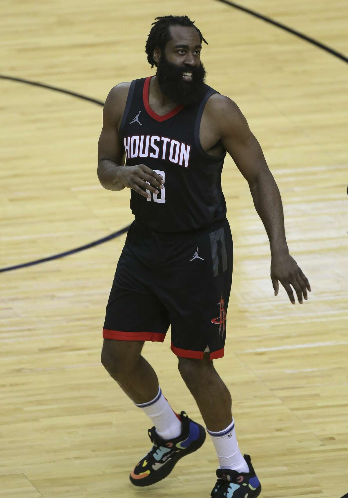 Houston Rockets guard James Harden (13) smiles after scoring a shot during the fourth quarter of a NBA game against the Dallas Mavericks Monday, Jan. 4, 2021, at Toyota Center in Houston.