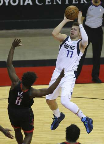 Dallas Mavericks guard Luka Doncic (77) goes for a jump shot during the fourth quarter of a NBA game against the Houston Rockets Monday, Jan. 4, 2021, at Toyota Center in Houston. Photo: Yi-Chin Lee/Staff Photographer / © 2021 Houston Chronicle