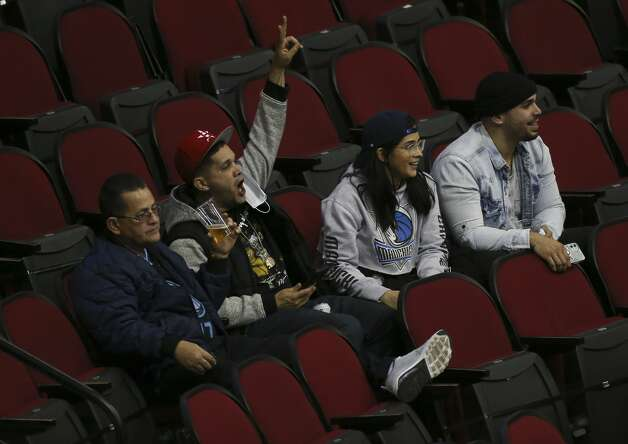 A Houston Rockets fan cheers for the team while his Dallas Mavericks fans are ignoring him before a NBA game Monday, Jan. 4, 2021, at Toyota Center in Houston. Photo: Yi-Chin Lee/Staff Photographer / © 2021 Houston Chronicle