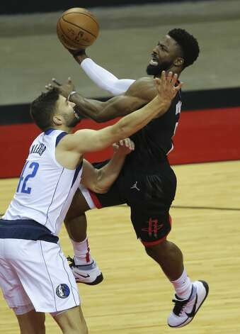 Houston Rockets David Nwaba (2) is fouled by Dallas Mavericks forward Maxi Kleber (42) during the first quarter of a NBA game Monday, Jan. 4, 2021, at Toyota Center in Houston. Photo: Yi-Chin Lee/Staff Photographer / © 2021 Houston Chronicle