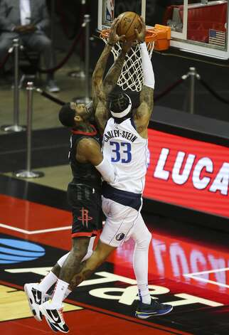 Houston Rockets guard John Wall (1) fouls on Dallas Mavericks center Willie Cauley-Stein (33) during the first quarter of a NBA game Monday, Jan. 4, 2021, at Toyota Center in Houston. Photo: Yi-Chin Lee/Staff Photographer / © 2021 Houston Chronicle