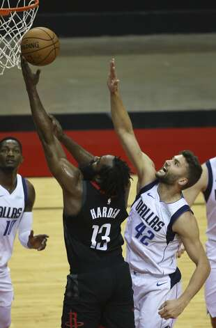 Houston Rockets guard James Harden (13) goes for the basket while Dallas Mavericks forward Maxi Kleber (42) is trying to stop him during the first quarter of a NBA game Monday, Jan. 4, 2021, at Toyota Center in Houston. Photo: Yi-Chin Lee/Staff Photographer / © 2021 Houston Chronicle