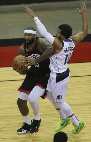 Houston Rockets center DeMarcus Cousins (15) drives past Dallas Mavericks guard Jalen Brunson (13) and scores the basket during the second quarter of a NBA game Monday, Jan. 4, 2021, at Toyota Center in Houston. Photo: Yi-Chin Lee/Staff Photographer / © 2021 Houston Chronicle