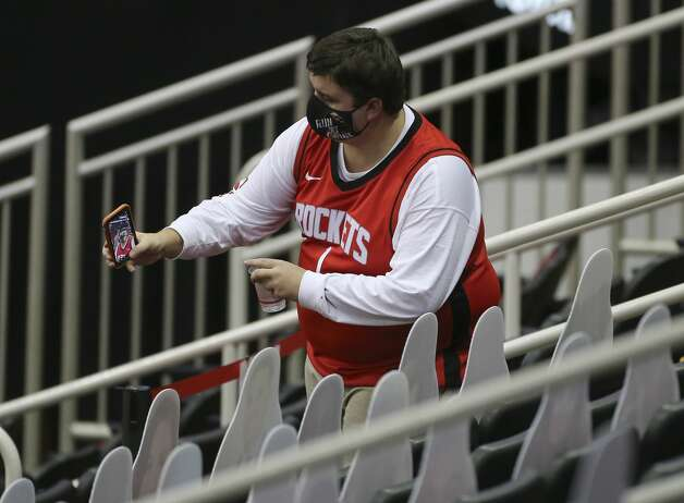 A Houston Rockets fan takes a selfie with Rockets fan cutouts before a NBA game Monday, Jan. 4, 2021, at Toyota Center in Houston. Photo: Yi-Chin Lee/Staff Photographer / © 2021 Houston Chronicle