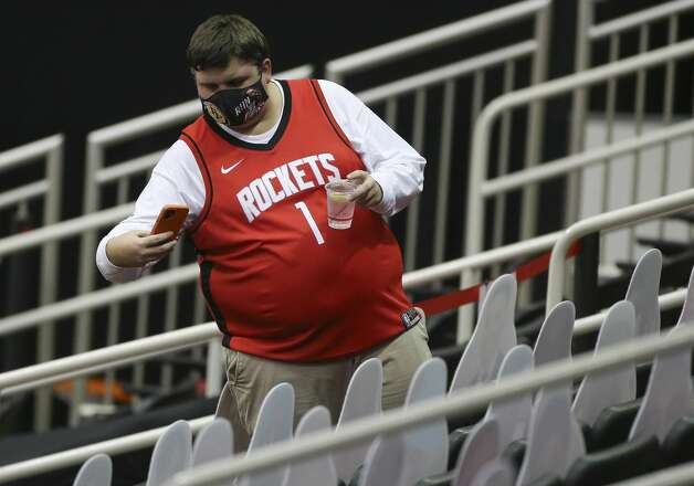 A Houston Rockets fan takes photographs of Rockets fan cutouts before a NBA game Monday, Jan. 4, 2021, at Toyota Center in Houston. Photo: Yi-Chin Lee/Staff Photographer / © 2021 Houston Chronicle