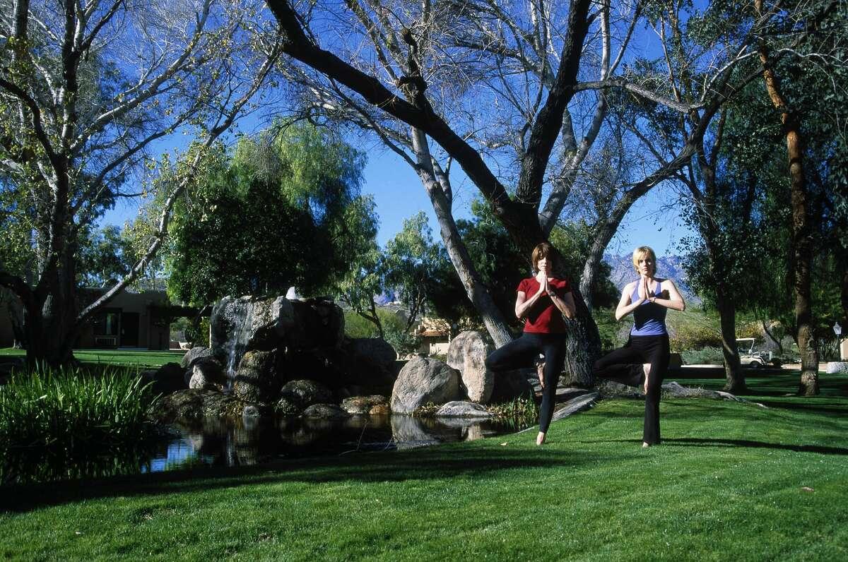 Two women doing yoga at Canyon Ranch in Tucson, Arizona.