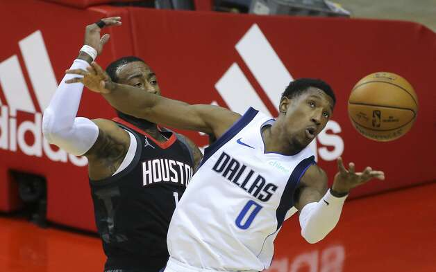 Dallas Mavericks forward Dorian Finney-Smith (10) catches a loose ball slipped from his hands during the first quarter of a NBA game against the Houston Rockets Monday, Jan. 4, 2021, at Toyota Center in Houston. Photo: Yi-Chin Lee/Staff Photographer / © 2021 Houston Chronicle