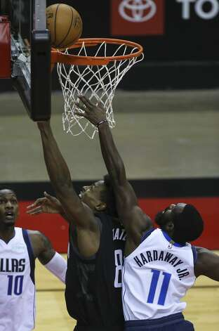 Houston Rockets forward Jae'Sean Tate (8) goes for the basket while Dallas Mavericks guard Tim Hardaway Jr. (11) is trying to stop him during the first quarter of a NBA game Monday, Jan. 4, 2021, at Toyota Center in Houston. Photo: Yi-Chin Lee/Staff Photographer / © 2021 Houston Chronicle