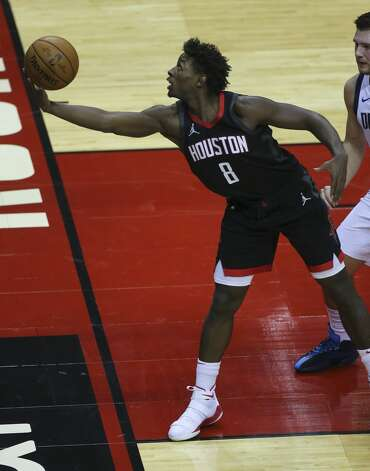 Houston Rockets forward Jae'Sean Tate (8) stretches to keep the ball in-bound during the first quarter of a NBA game against the Dallas Mavericks Monday, Jan. 4, 2021, at Toyota Center in Houston. Photo: Yi-Chin Lee/Staff Photographer / © 2021 Houston Chronicle