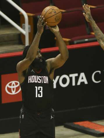 Houston Rockets guard James Harden (13) aims for a three point basket during the third quarter of a NBA game against the Dallas Mavericks Monday, Jan. 4, 2021, at Toyota Center in Houston. Photo: Yi-Chin Lee/Staff Photographer / © 2021 Houston Chronicle
