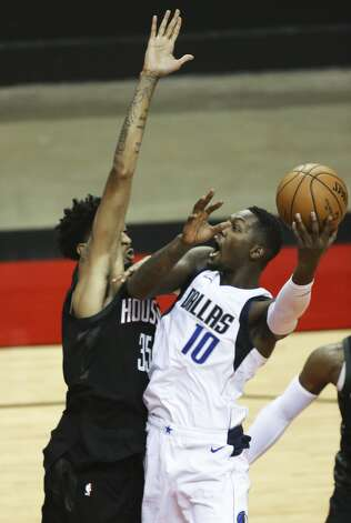 Dallas Mavericks forward Dorian Finney-Smith (10) goes for the basket while Houston Rockets forward Christian Wood (35) is trying to stop him during the third quarter of a NBA game Monday, Jan. 4, 2021, at Toyota Center in Houston. Photo: Yi-Chin Lee/Staff Photographer / © 2021 Houston Chronicle