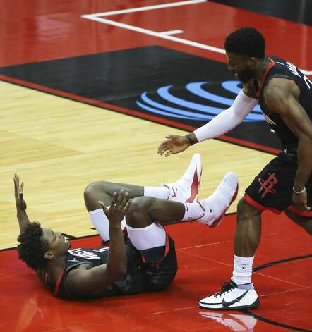 Houston Rockets David Nwaba (2) helps Houston Jae'Sean Tate (8) to get up after Tate was fouled during the third quarter of a NBA game against the Dallas Mavericks Monday, Jan. 4, 2021, at Toyota Center in Houston. Photo: Yi-Chin Lee/Staff Photographer / © 2021 Houston Chronicle