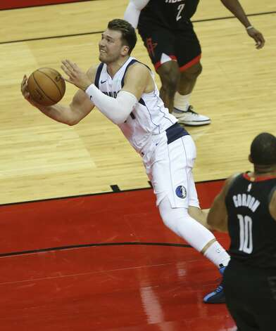 Dallas Mavericks guard Luka Doncic (77) falls onto the floor during the third quarter of a NBA game against the Houston Rockets Monday, Jan. 4, 2021, at Toyota Center in Houston. Photo: Yi-Chin Lee/Staff Photographer / © 2021 Houston Chronicle