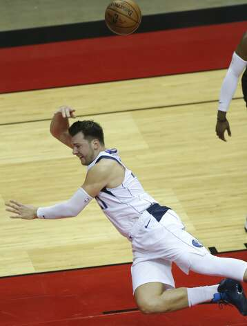 Dallas Mavericks guard Luka Doncic (77) tries to keep the ball in-play as he is falling onto the floor during the third quarter of a NBA game against the Houston Rockets Monday, Jan. 4, 2021, at Toyota Center in Houston. Photo: Yi-Chin Lee/Staff Photographer / © 2021 Houston Chronicle