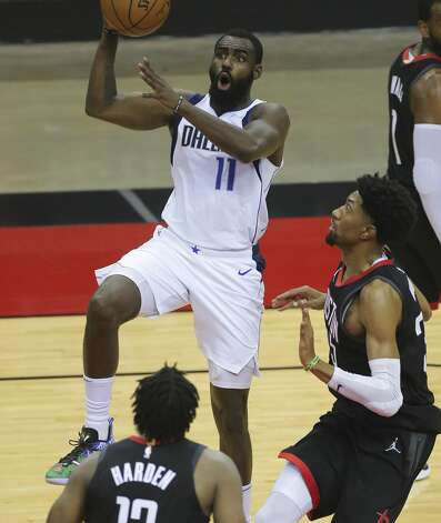 Dallas Mavericks guard Tim Hardaway Jr. (11) goes for a lay up during the fourth quarter of a NBA game against the Houston Rockets Monday, Jan. 4, 2021, at Toyota Center in Houston. Photo: Yi-Chin Lee/Staff Photographer / © 2021 Houston Chronicle