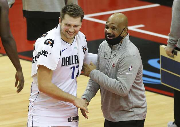 Dallas Mavericks guard Luka Doncic (77) shakes hands with Houston Rockets Assistant Coach John Lucas after a NBA game Monday, Jan. 4, 2021, at Toyota Center in Houston. Photo: Yi-Chin Lee/Staff Photographer / © 2021 Houston Chronicle