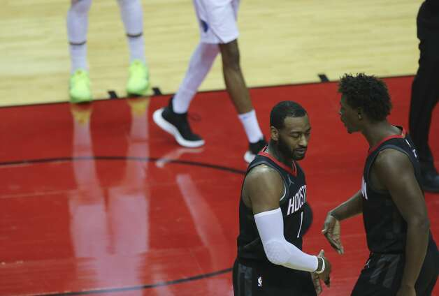 Houston Rockets guard John Wall (1) high-fives with Jae'Sean Tate (8) during the second quarter of a NBA game against the Dallas Mavericks Monday, Jan. 4, 2021, at Toyota Center in Houston. Photo: Yi-Chin Lee/Staff Photographer / © 2021 Houston Chronicle