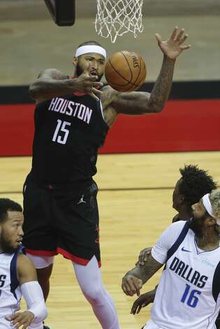 Houston Rockets center DeMarcus Cousins (15) grabs his own rebound during the second quarter of a NBA game against the Dallas Mavericks Monday, Jan. 4, 2021, at Toyota Center in Houston. Photo: Yi-Chin Lee/Staff Photographer / © 2021 Houston Chronicle