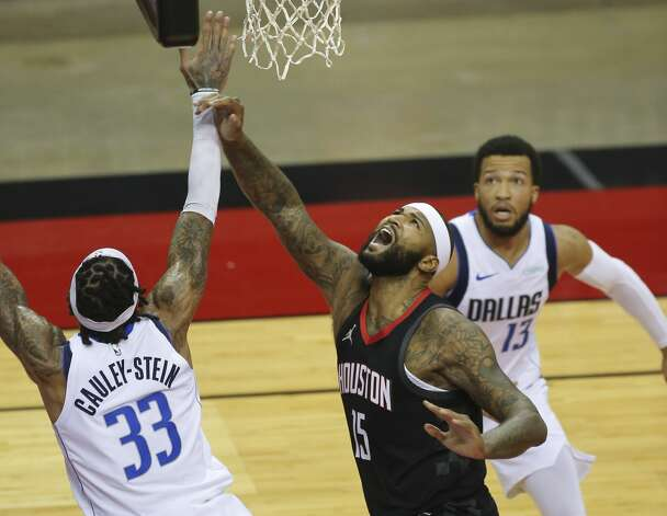 Houston Rockets center DeMarcus Cousins (15) goes for the basket while Dallas Mavericks center Willie Cauley-Stein (33) is trying to stop him during the second quarter of a NBA game Monday, Jan. 4, 2021, at Toyota Center in Houston. Photo: Yi-Chin Lee/Staff Photographer / © 2021 Houston Chronicle
