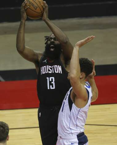 Houston Rockets guard James Harden (13) is fouled by Dallas Mavericks center Dwight Powell (7) during the second quarter of a NBA game Monday, Jan. 4, 2021, at Toyota Center in Houston. Photo: Yi-Chin Lee/Staff Photographer / © 2021 Houston Chronicle