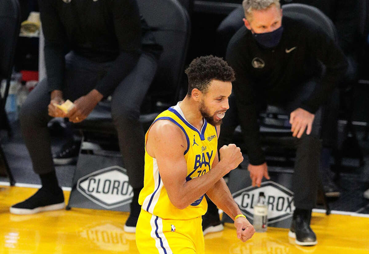 Stephen Curry reacts after hitting a 3-pointer in the first half Monday against the Kings at Chase Center.