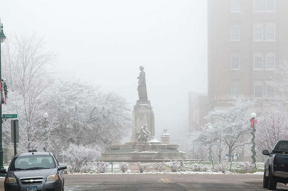 Dense fog lingered across west-central Illinois on Monday, causing hazardous driving conditions. Visibility was reduced to a quarter of a mile much of the day, according to the National Weather Service, giving places like downtown Jacksonville a hazy appearance. Photo: Darren Iozia | Journal-Courier