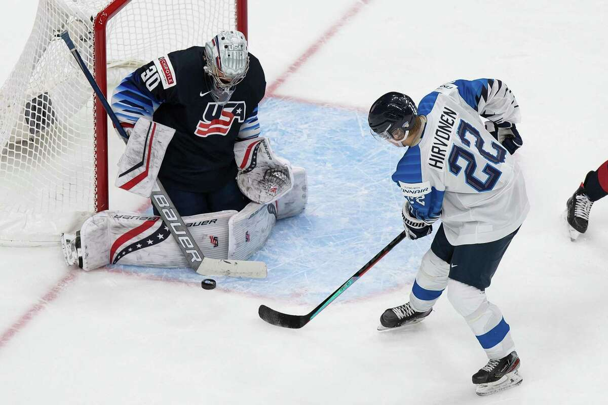 EDMONTON, AB - JANUARY 04: Goaltender Spencer Knight #30 of the United States makes a save against Roni Hirvonen #22 of Finland during the 2021 IIHF World Junior Championship semifinals at Rogers Place on January 4, 2021 in Edmonton, Canada. (Photo by Codie McLachlan/Getty Images)