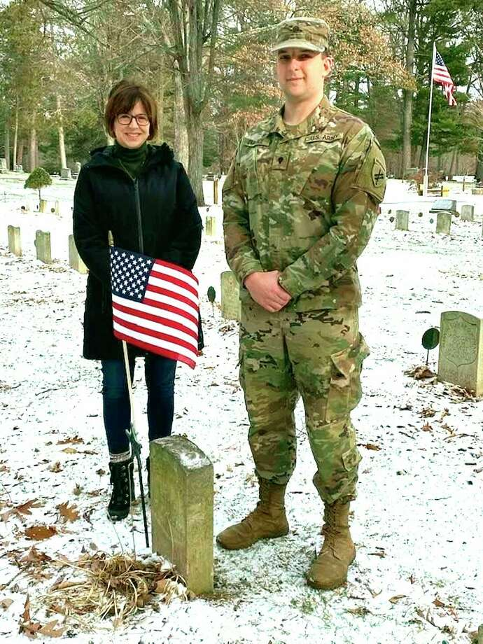 Robbyn Durance and her son, Specialist Peter Durance of the U. S. Army Reserves, stand by the Civil War headstone of their ancestor Henry White. Henry White enlisted in the 5th Cavalry Regiment of New York State in 1862. He was wounded and honorably discharged in 1863. (Photo provided)