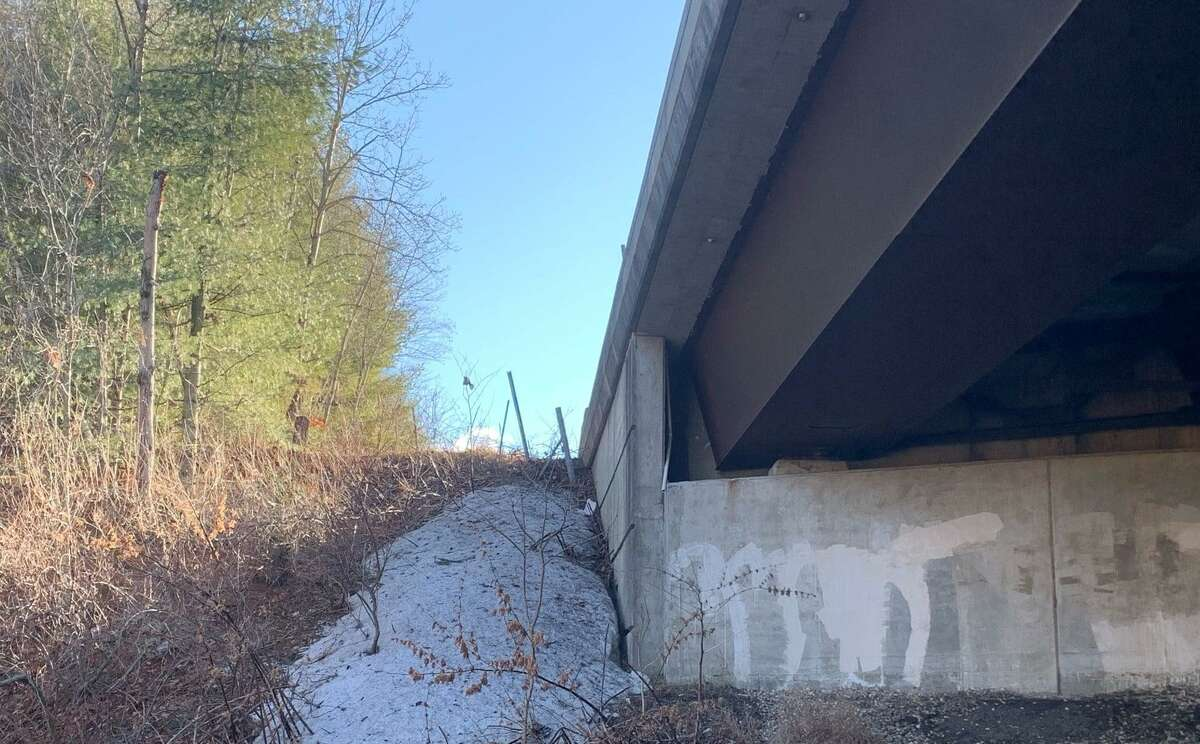 One of the embankments state police say the driver crashed down after losing control on Route 8 in Beacon Falls, Conn., on Monday, Jan. 4, 2021.