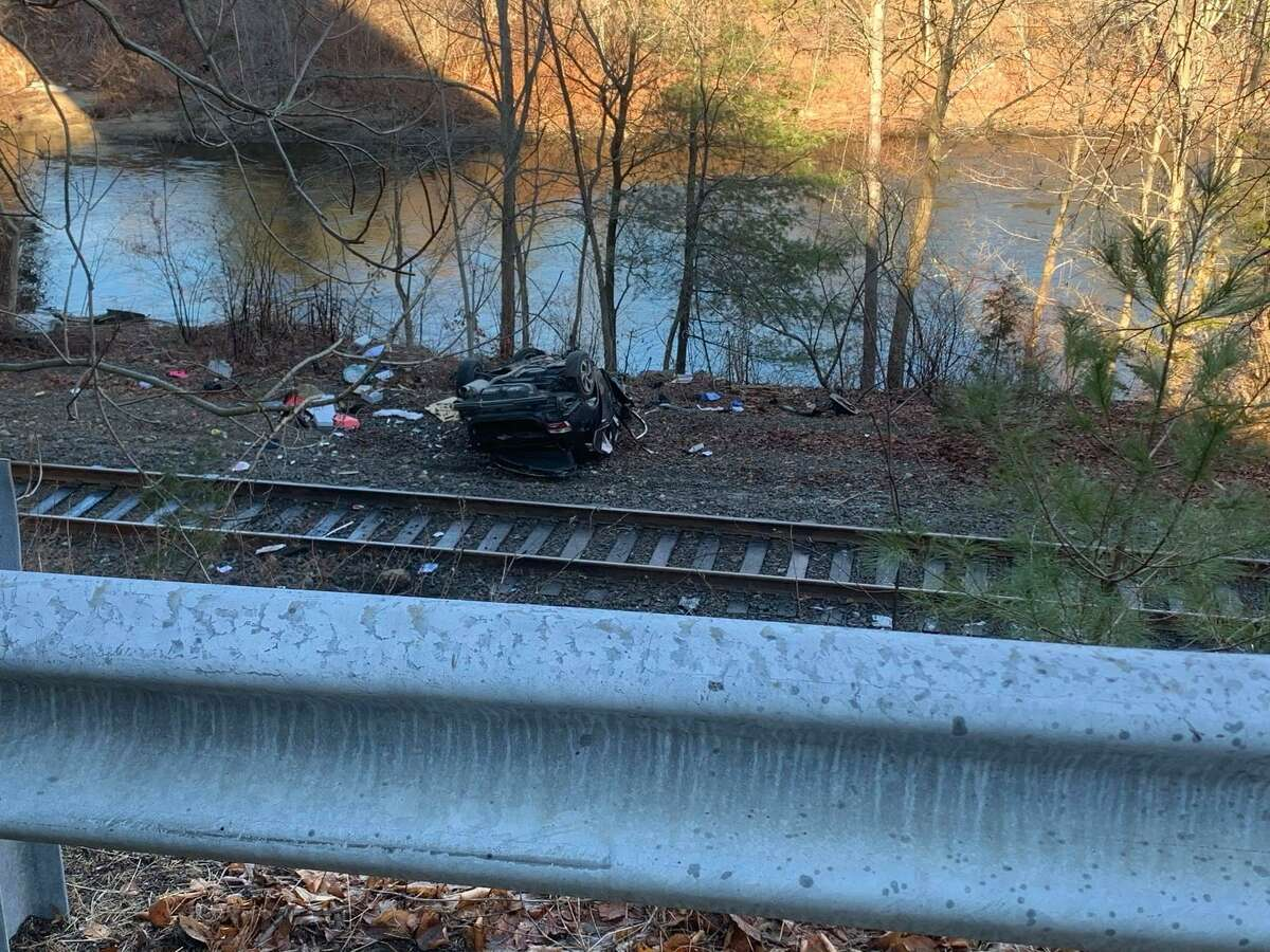 The aftermath of a major crash where a driver lost control on Route 8 and crashed down two embankment, ending with the vehicle on its roof near the bank of the Naugatuck River in Beacon Falls, Conn., on Monday, Jan. 4, 2021.