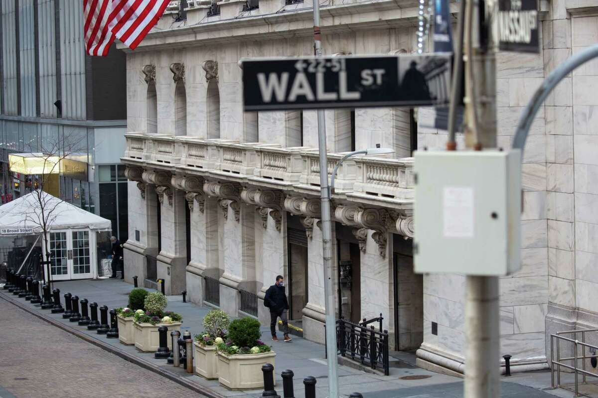 A person enters the New York Stock Exchange in New York on Jan. 4, 2021.