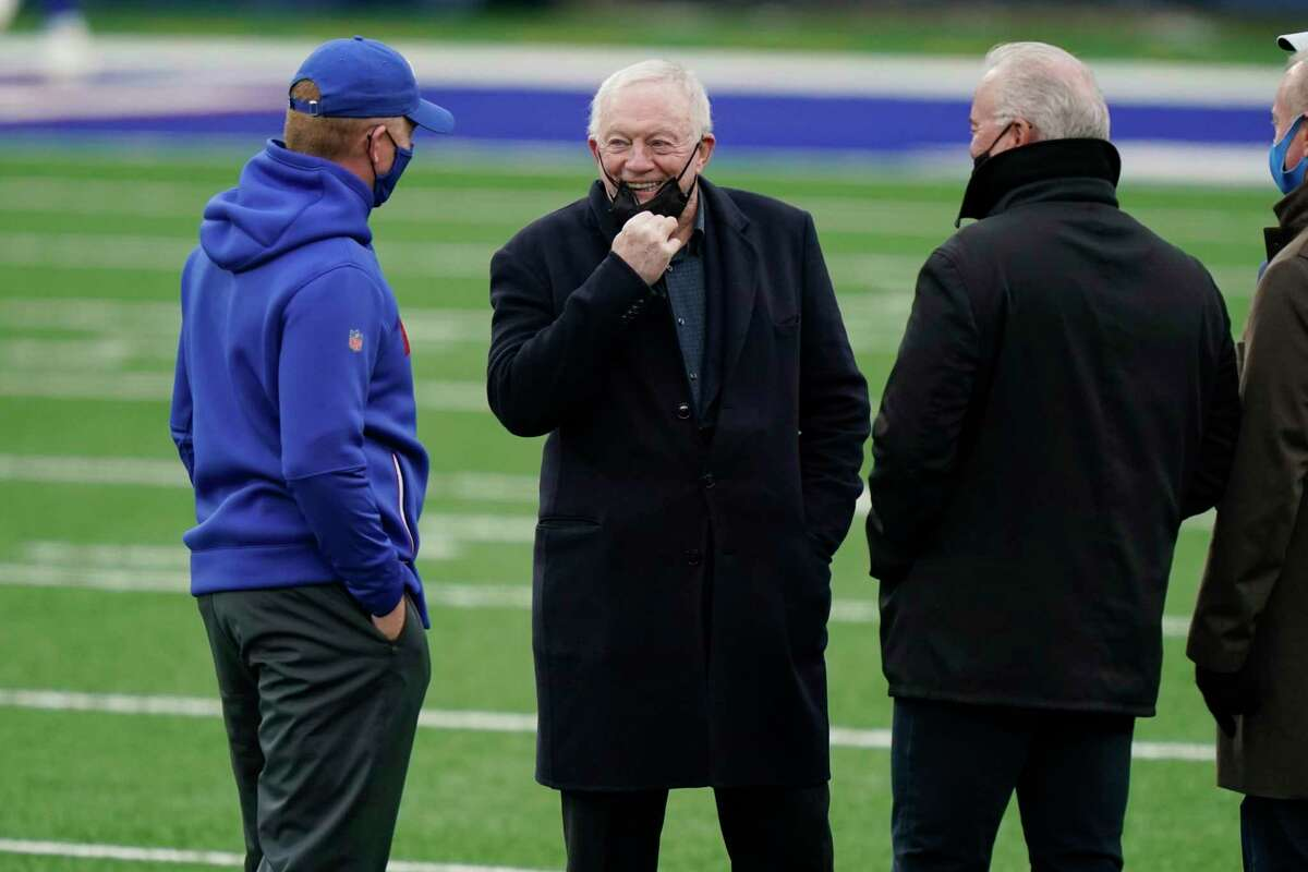 Dallas Cowboys owner Jerry Jones talks with people on the field before an NFL football game between the New York Giants and the Dallas Cowboys, Sunday, Jan. 3, 2021, in East Rutherford, N.J. (AP Photo/Corey Sipkin)