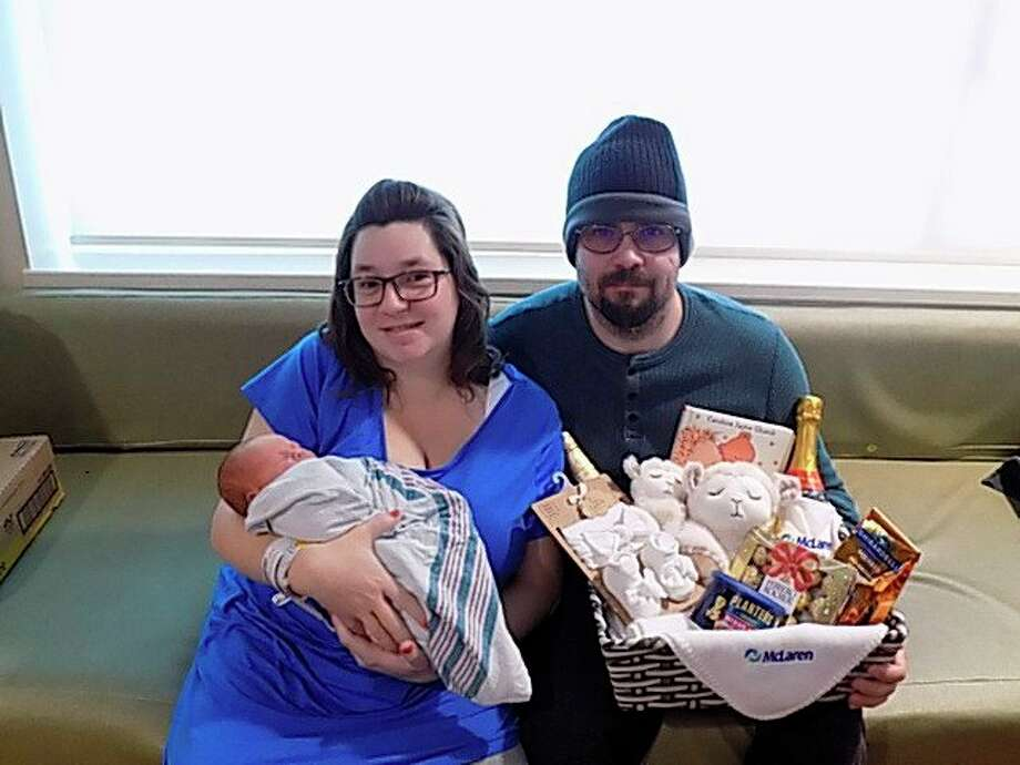 Brenda and Geoffrey Fearson with their newborn daughter Olivia. Olivia was born an hour into the new year, making her the first new birth in Huron County of 2021. (Courtesy Photo/McLaren Thumb Region)