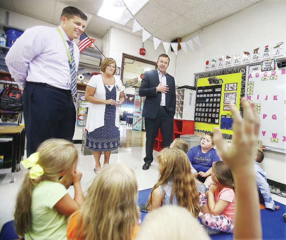 Sen. Andy Manar, right, D-Bunker Hill, visits a first-grade classroom at Brighton North Primary School with school Principal Diane Milnor, center, and superintendent Brad Skertich in 2018. Photo: John Badman| Hearst Illinois