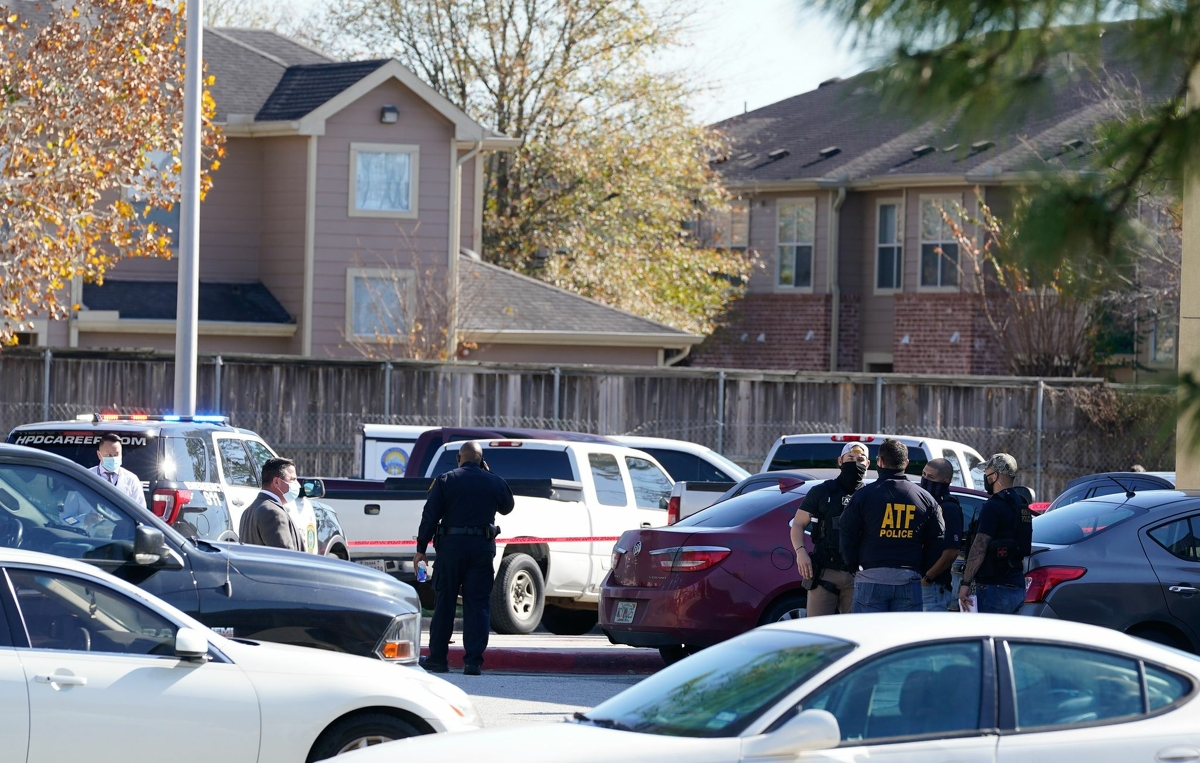 Police are shown at the scene of an officer involved shooting at a business at 16510 North Freeway Tuesday, Jan. 5, 2021 in Houston.