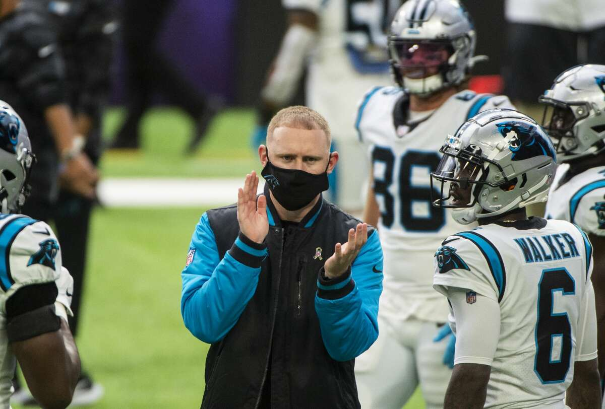 MINNEAPOLIS, MN - NOVEMBER 29: Carolina Panthers offensive coordinator Joe Brady speaks with players before the game against the Minnesota Vikings at U.S. Bank Stadium on November 29, 2020 in Minneapolis, Minnesota. (Photo by Stephen Maturen/Getty Images)
