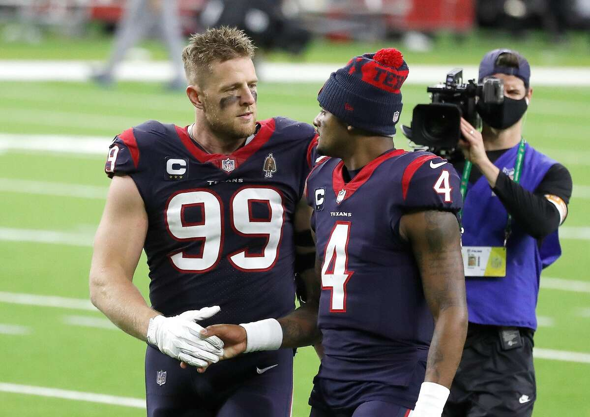 Houston Texans defensive end J.J. Watt (99) shakes hands with quarterback Deshaun Watson (4) walk back to the locker room after the Houston Texans 41-38 loss after the fourth quarter of an NFL football game Sunday, Jan. 3, 2021, at NRG Stadium in Houston .