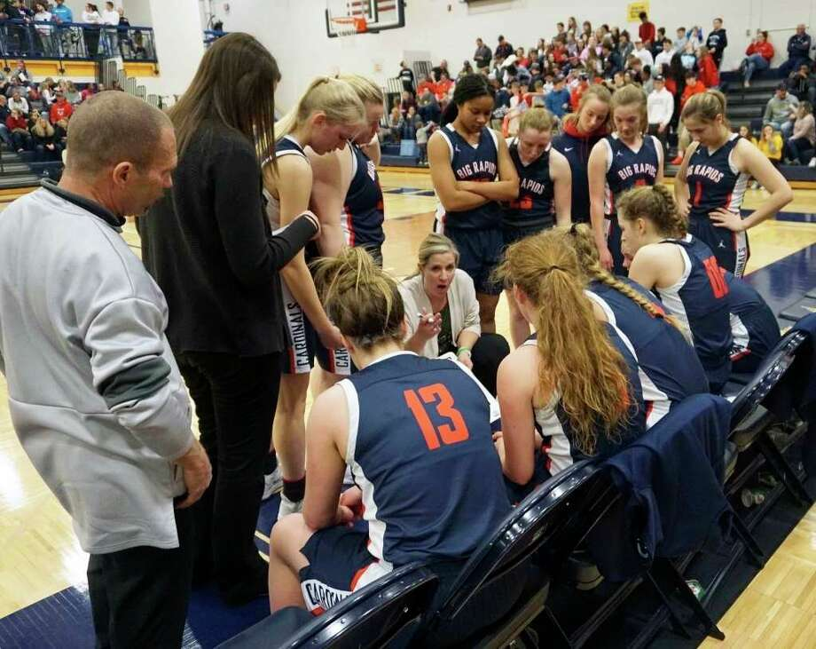 Big Rapids girls basketball coach Jessica Haist speaks with her team in a timeout during last season's district title game against Cadillac. (Pioneer file photo)
